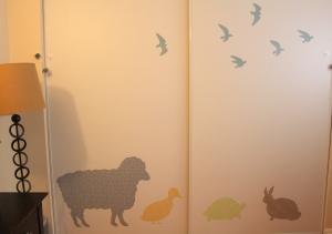 organic fabric animals on jack's wall